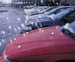 Hail storm damages a car, lots of minor dents!
