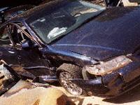 This Honda 4 door car needed new doors, windshield repairs, and crumple zone repairs.
