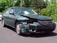 This green Chevy Malibu needed body work after a front-end collision.